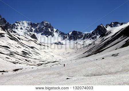 Hiker in snowy mountains at nice day. Turkey Kachkar Mountains in spring (highest part of Pontic Mountains).