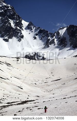 Hiker in snowy mountains at nice spring day. Turkey Kachkar Mountains (highest part of Pontic Mountains).