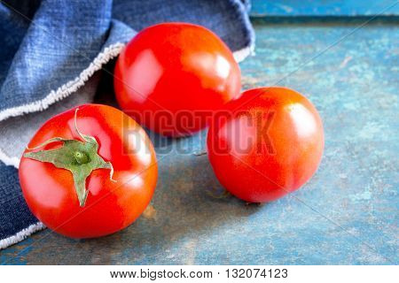 Fresh Organic Tomatoes On A Wooden Table, Selective Focus.