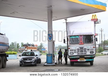 Pune, India - June 27, 2015: Cars and trucks filling petrol and diesel at a gas station in india.