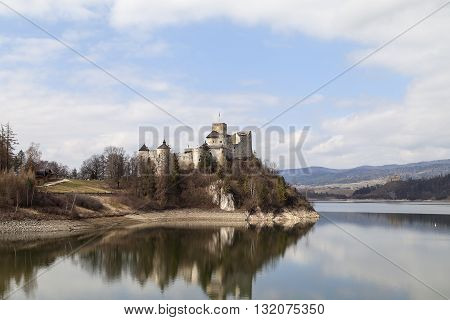 XIV century Niedzica Castle on the lake Czorsztyn on a sunny day Poland Europe