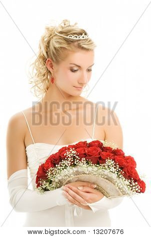 Beautiful bride with a luxury bouquet of red roses. Isolated on white background