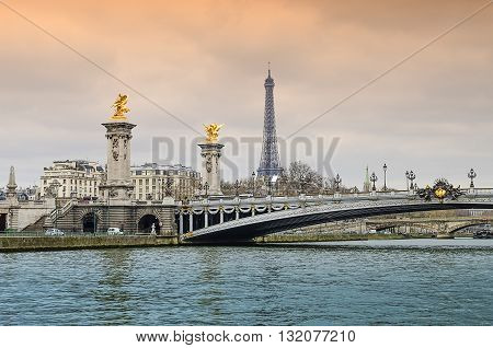 Eiffel Tower and Pont Alexandre III over the Seine in Paris France