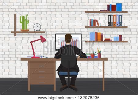 Back view of Business Man working on desktop computer in the modern office
