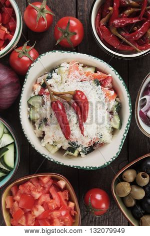 Shopska salad with cheese, tomato, cucumber, onion and chili peppers