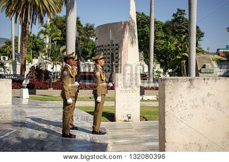 Santiago de Cuba Cuba - January 10 2016: Guard mounting or changing the guard at the Mausoleum of Jose Marti in the cemetery of Santa Ifigenia in Santiago de Cuba. Santiago is the 2nd largest city in Cuba