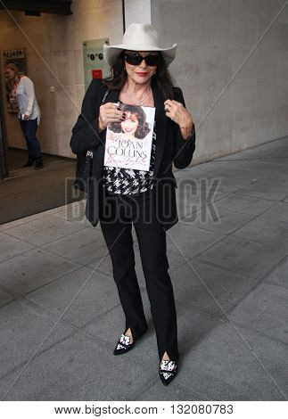 LONDON, UK - OCTOBER 25, 2013: Joan Collins seen arriving at the BBC studios to promote her new book