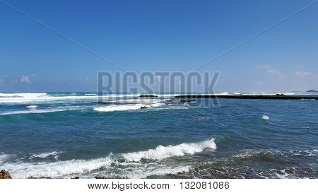 Waves roll into Kuilima Cove on the North Shore of Oahu Hawaii.
