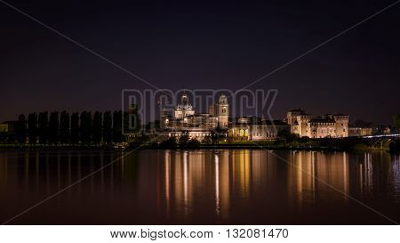 Mantua, Italy - April 24, 2015: Mantua nightscape reflection on the river