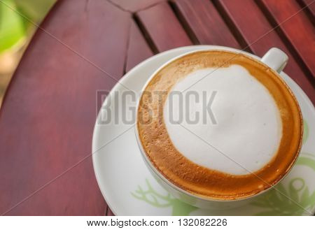 Latte Coffee on the wooden table