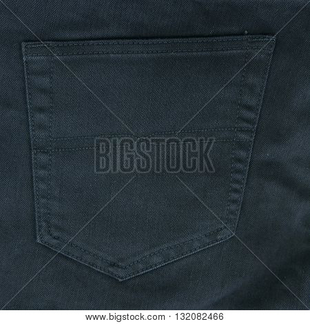 Bellow Pocket of  Black jeans as background