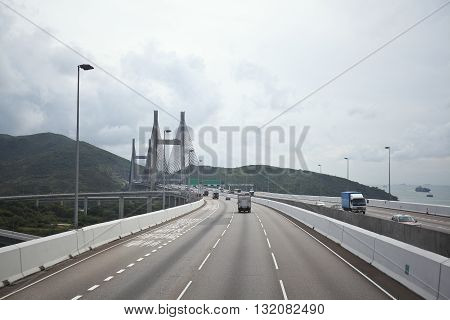 On The Left Side At Highway Driving Route And Bridge