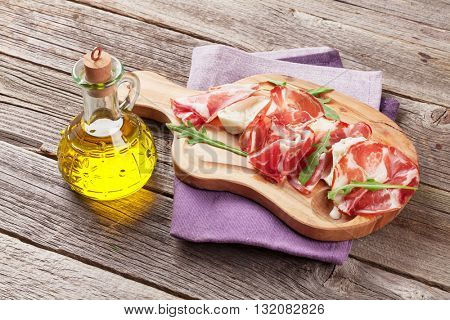Prosciutto and mozzarella on wooden table