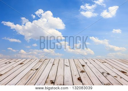 Beautiful blue sky and old wood floor background.