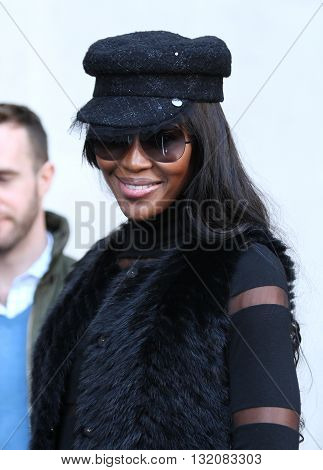 LONDON, UK - OCTOBER 29, 2013: Naomi Campbell seen greeting fans while leaving the BBC building