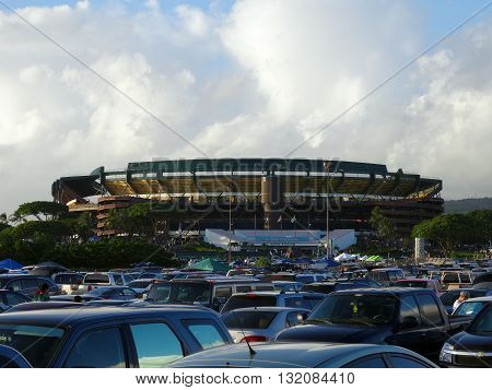 HONOLULU - SEPTEMBER 19: Cars fill parking lot leading to Aloha Stadium before start of College football game on September 19 2015.