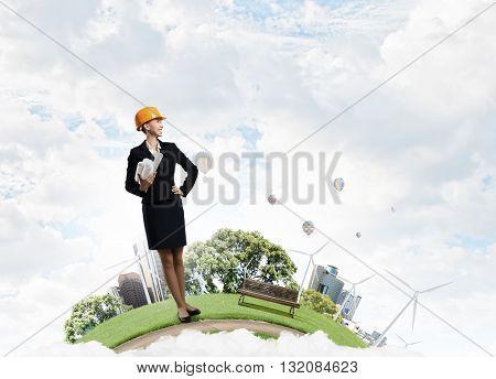 Woman builder on platform