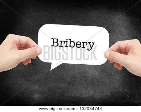 Bribery written on a speechbubble