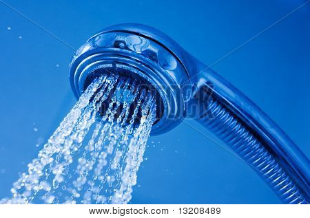 Shower nozzle sprays water down