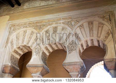 MALAGA, SPAIN - JULY 11, 2008 - Ornate arches within the Nasrid Palace Malaga Castle (Alcazaba de Malaga) Malaga Malaga Province Andalucia Spain Western Europe, July 11, 2008.