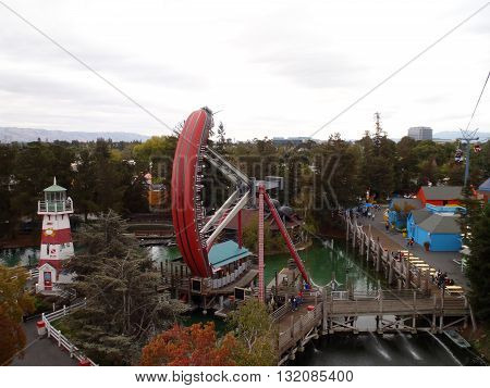 SANTA CLARA - AUGUST 7: Aerial view of Great America theme park featuring the Pirate ship ride swinging and a variety of shops on August 7 2010 Great America Park Santa Clara California.