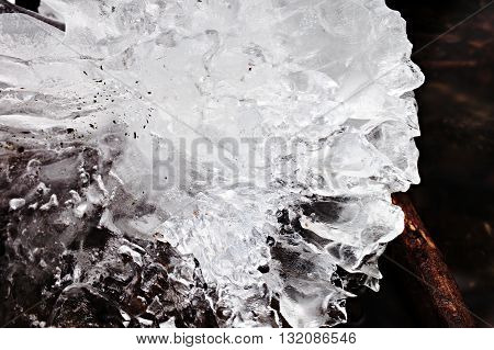 Beautiful Big Piece Of Ice With Abstract Cracks. Icicle Bellow Waterfall, Stony And Messy Stream Ban