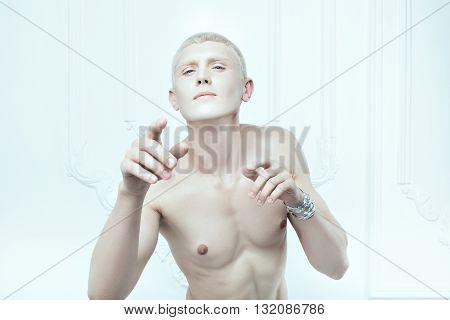Portrait of a male albino with white skin.