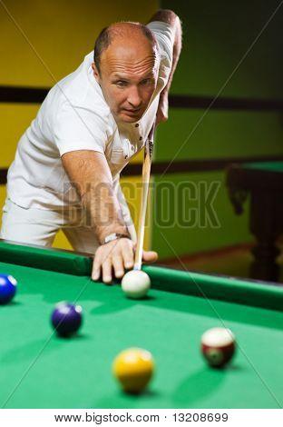 Man playing billiards