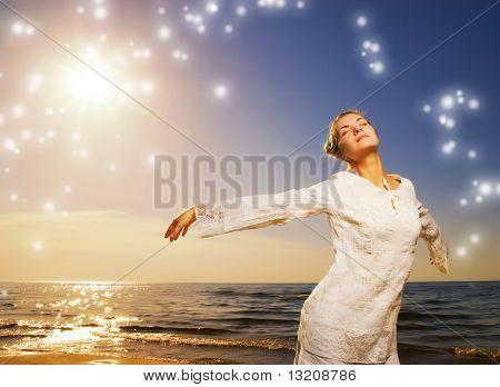 Beautiful young woman relaxing near the ocean