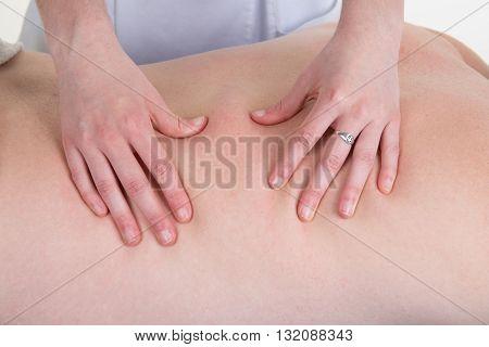 Closeup Of Professional Back Massage At Spa