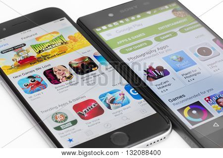 Melbourne, Australia - May 23, 2016: Close-up view of Google Play Store on Android smartphone and Apple's App Store on iPhone