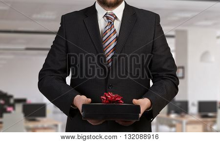 Businessman hold gift box