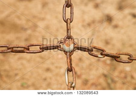 Joined Old Rusty Chain In Cross, Close Up View Of Chain And Screw