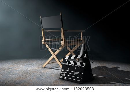 Director Chair Movie Clapper and Megaphone in the volumetric light on a black background. 3d Rendering