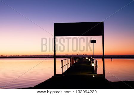 Morning In Harbor. Tourists Pier Above Sea. Sunny Clear Blue Sky, Smooth Water Level