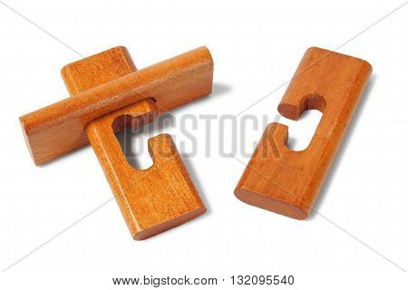 Simple classic wooden puzzle on white background