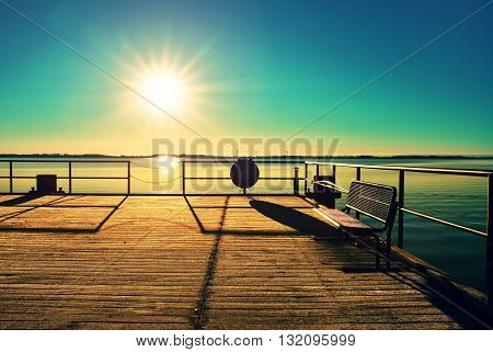 Empty Wooden Pier At Beautiful Colorful Morning. Tourist Wharf In Sea Bay.
