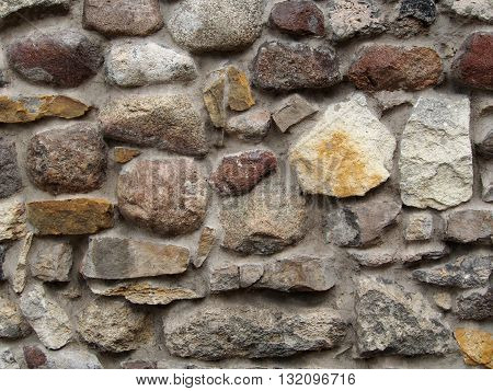 Wall made from concrete and stones can be used as a background