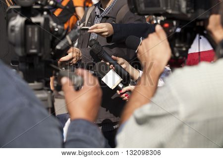 Press interview. Filming an event with a video camera.