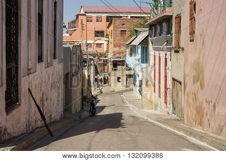 Typical scene of one of streets in the center of Santiago de cuba - Colorful architecture. Santiago is the 2nd largest city in Cuba