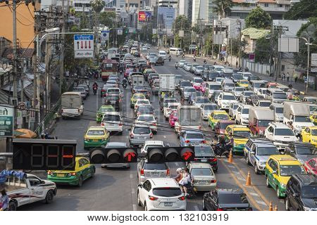 BANGKOK THAILAND - APR 29 : scene of traffic jam in Asoke junction on april 29 2016 thailand. traffic jam is one of worse issue of Bangkok