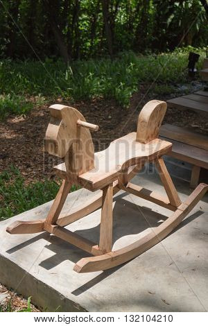 Children toy of wooden rocking horse stock photo
