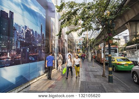 BANGKOK THAILAND - APR 29 : unidentified people on footpath at Sukhumvit road near Asoke area on april 29 2016 thailand.