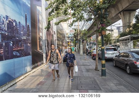 BANGKOK THAILAND - APR 29 : unidentified people on pavement at Sukhumvit road near Asoke area on april 29 2016 thailand.