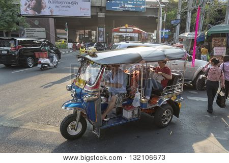 BANGKOK THAILAND - APR 30 : tuktuk service passenger in Sukhumwit road at Nana area on april 30 2016 thailand. tuktuk is popular taxi service of tourists in bangkok