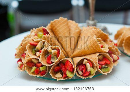 dessert of fresh fruit on the table.