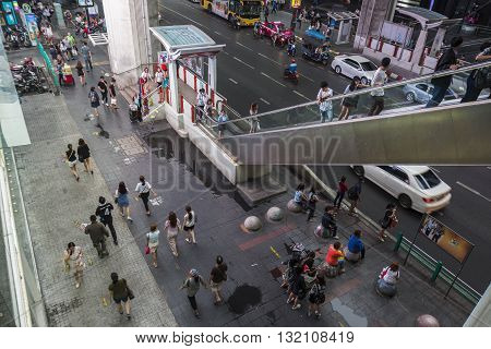 BANGKOK THAILAND - APR 30 : scene of people on footpath of Siam Square from BTS siam station on april 30 2016 thailand. siam square is famous shopping place of Bangkok