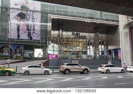 BANGKOK THAILAND - APR 30 : traffic on Rama 1 road at Siam Center shopping mall in Siam Square on april 30 2016 thailand. Siam Square is famous shopping place of Bangkok