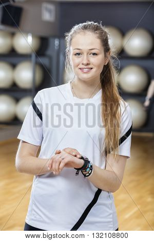 Smiling Young Woman Wearing Activity Tracker