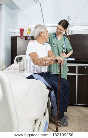 Patient And Nurse Looking At Each Other In Rehabilitation Center